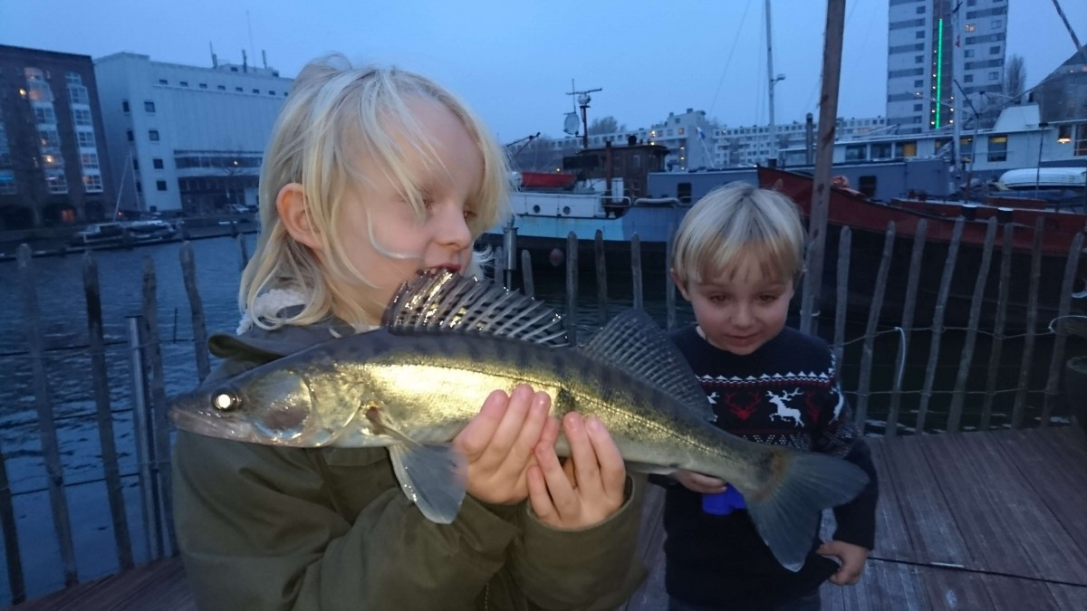 Our son with a zander caught from the houseboat.