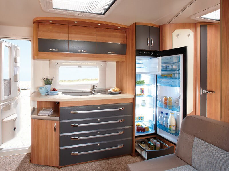 The kitchen is also  surprisingly spacious and has a large fridge
