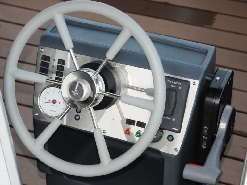 The steering wheel is integrated in the design of this unique houseboat.