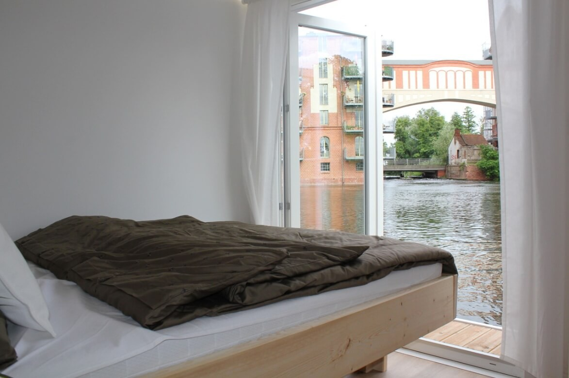 Comfortable double bedroom with water view.