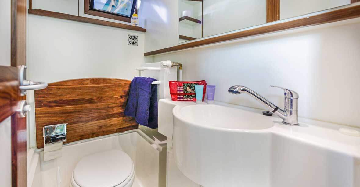 The boat offers a convenient and modern bathroom.