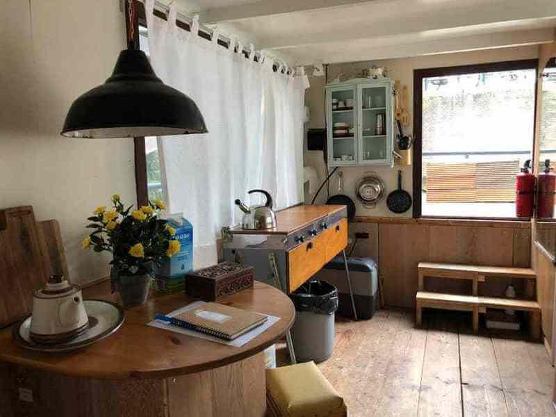 Log cabin boat with vintage interior
