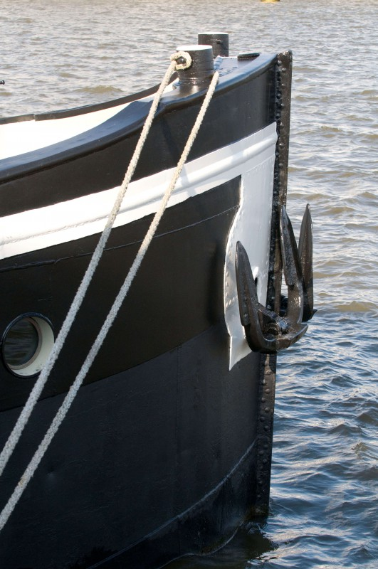 Room 1 is located in the bow of the boat.
