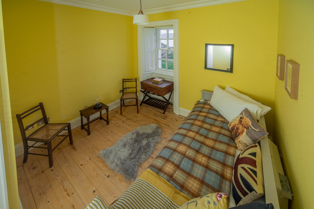 The yellow bedroom is also ensuite
