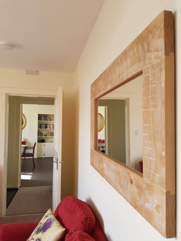 We loved this wooden mirror - it fits our seaside style