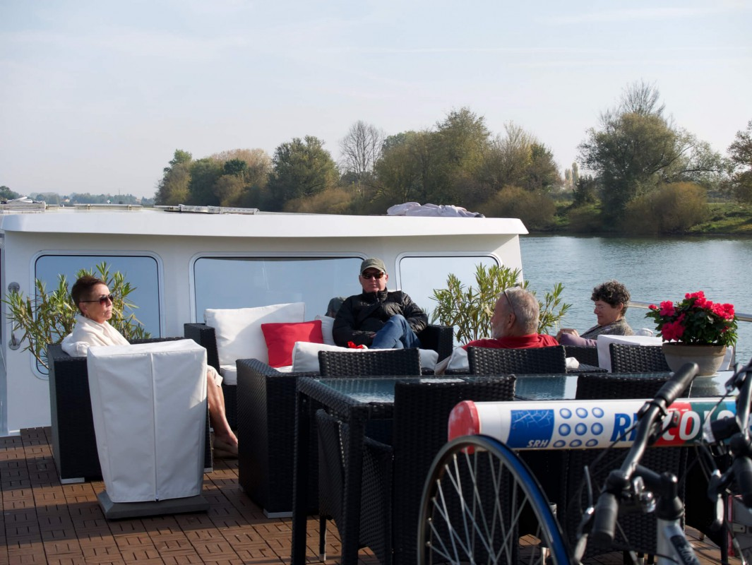 Guests relax on the Grand Victoria front deck while cruising the the River Saône
