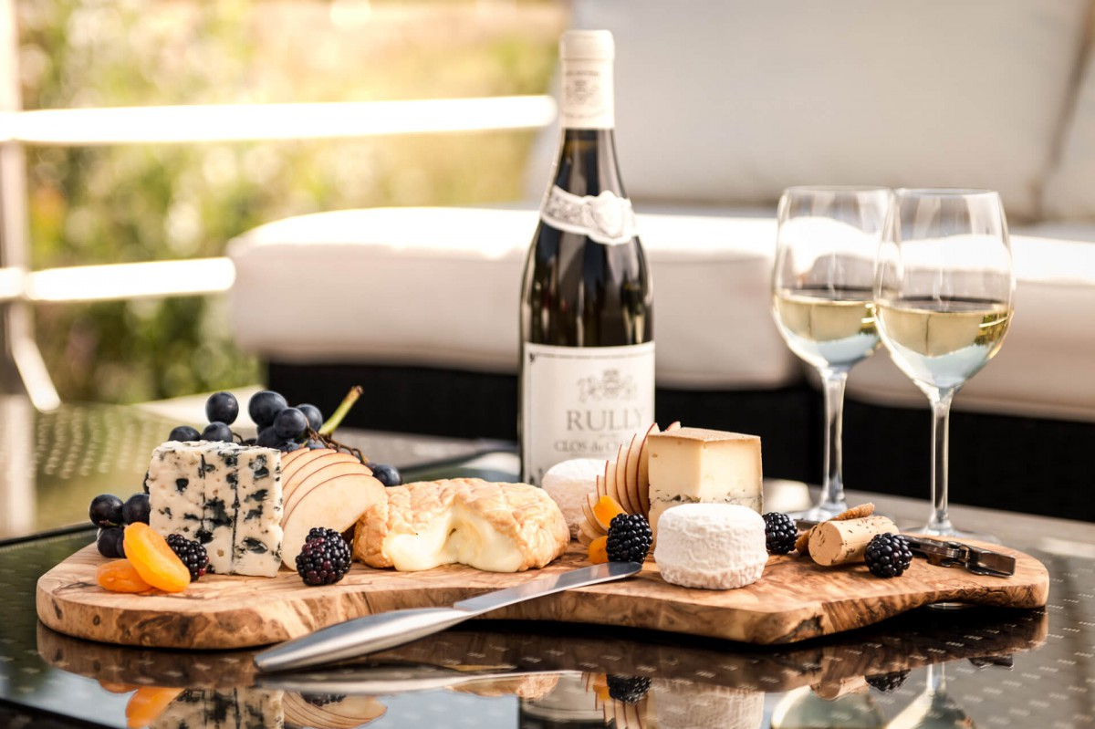 Happy hour on board the luxury yacht Grand Victoria with a selection of French cheeses