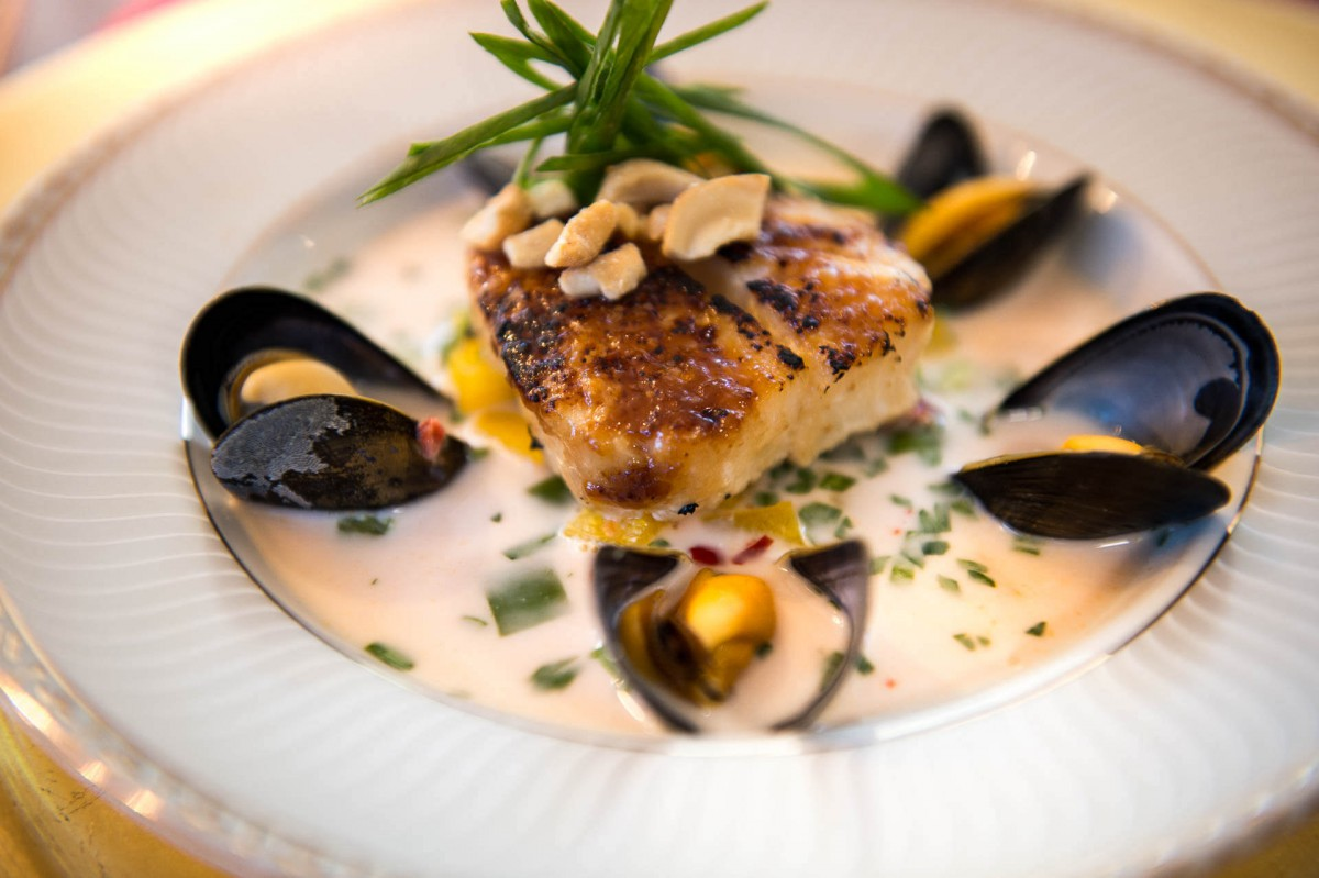 Sea bass and mussels in a curry cream sauce on the luxury yacht Grand Victoria