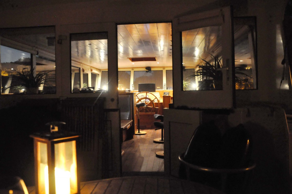 View into the wheelhouse from the aft deck.