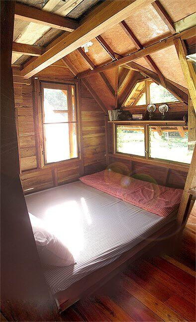 One of the beds in the treehouse