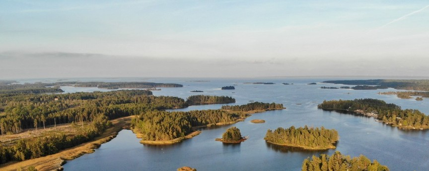 Archipelago. Photo from a drone flying over the ocean bay where the cottage is situated