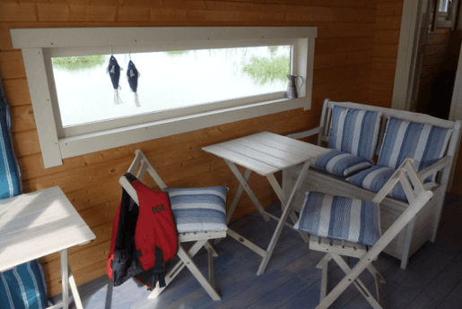 Comfy sitting area inside the houseboat