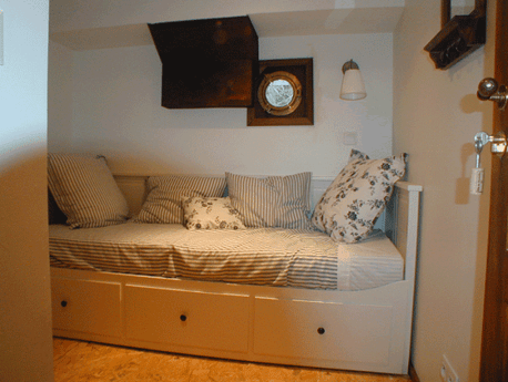 Bedroom with a convertible bed
