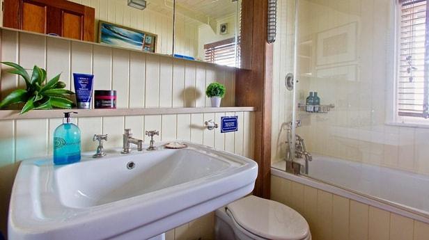 Bathroom 2: decent sized basin and a bath/shower
