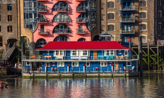 Extraordinary houseboat near Tower Bridge from the river