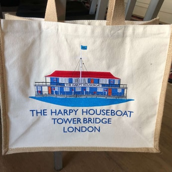 Harpy embroidered jute shopping bags.
