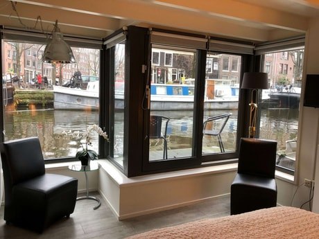 large windows with seating and outsidedeck with seating