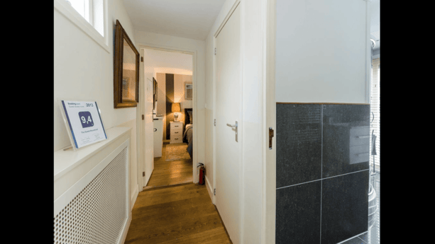 Hall to bathroom and toilet