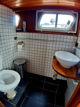 Toilet and shower cabin