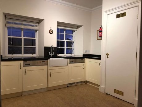 Utility room with Miele appliances and   American Fridge Freezer