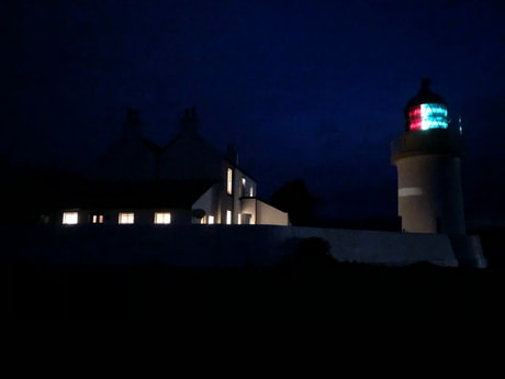 Lighthouse and Lodge by night