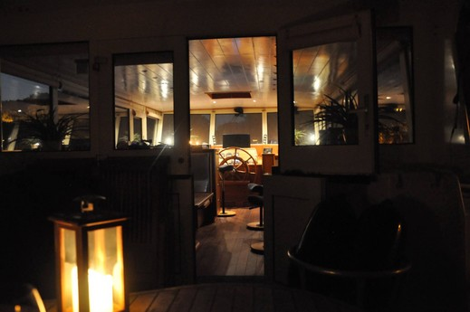 View from the aft deck into the wheelhouse.