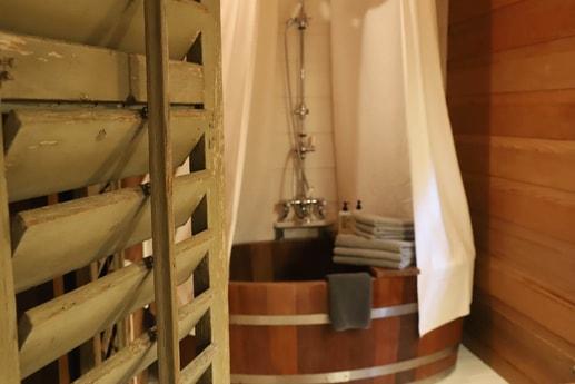 The bathtub in the Stunning Treehouse with Hammock Bathroom