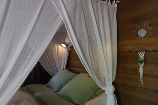 The double bed in treehouse King Louie