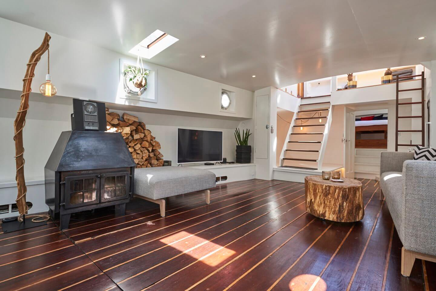 A wood stove provides comfortable warmth on a houseboat
