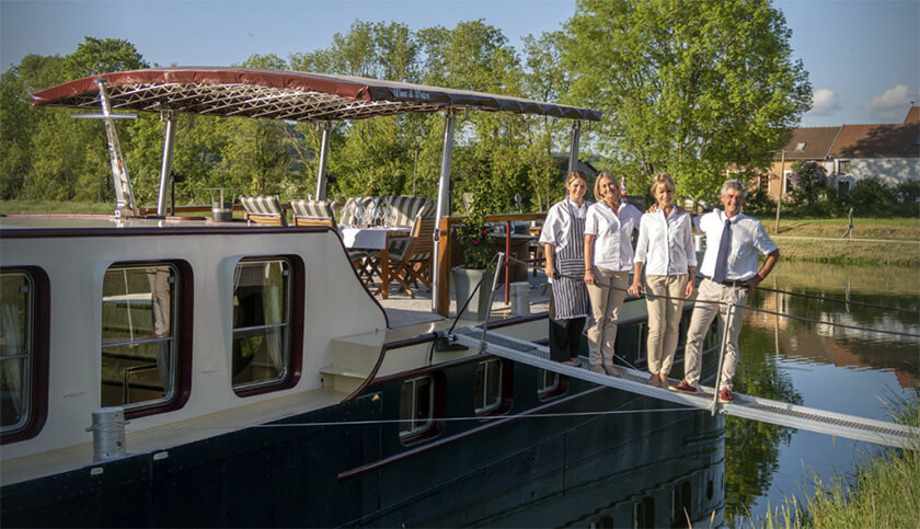 Private crew of a barge river cruise