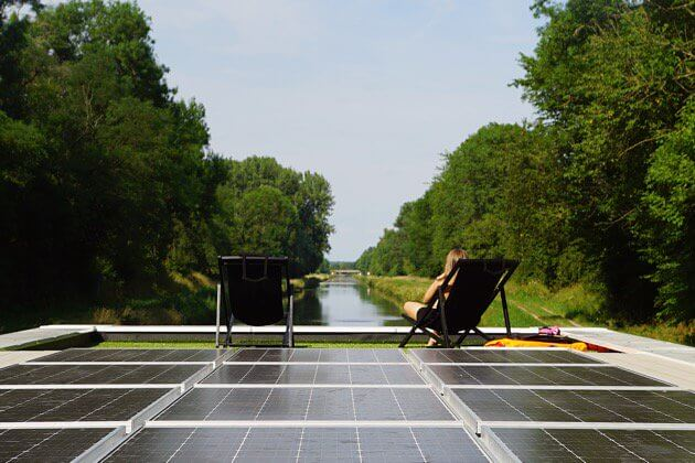 Solar panels collect energy for this houseboat