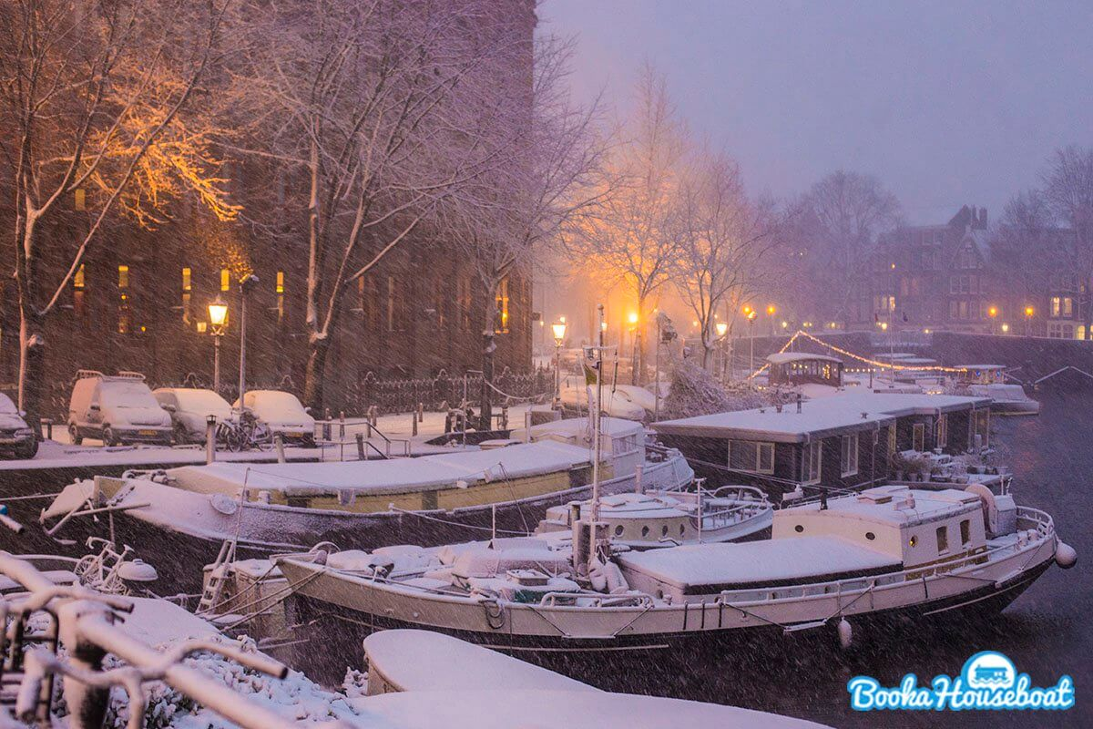Concrete barges and traditional ships in Amsterdam winter