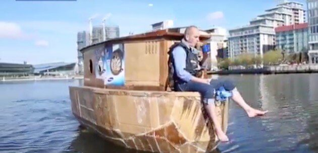 The crew and camerateam driving the cardboard houseboat.